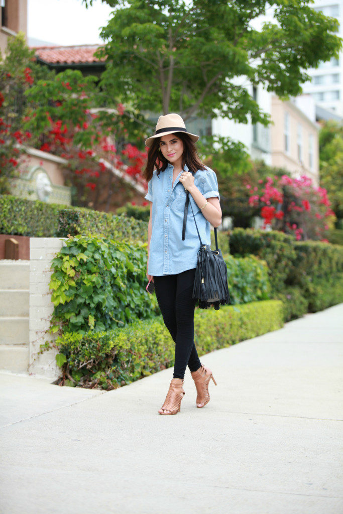 Street Style Fashion: Sazan is wearing a Topman denim shirt, black Nordstrom leggings, beige Vince Camuto heels and a fringe sidebag