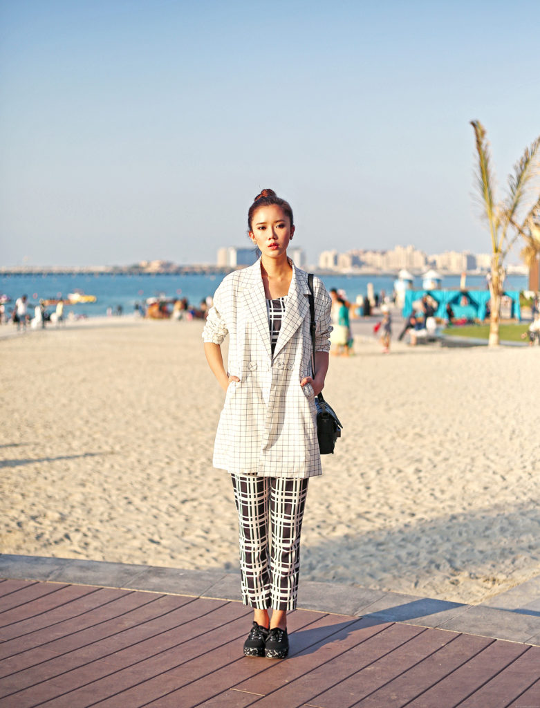 Street Style, April 2015: Camille is wearing black and white Style Moi jumpsuit with a checked Romwe jacket and Keds black sneakers