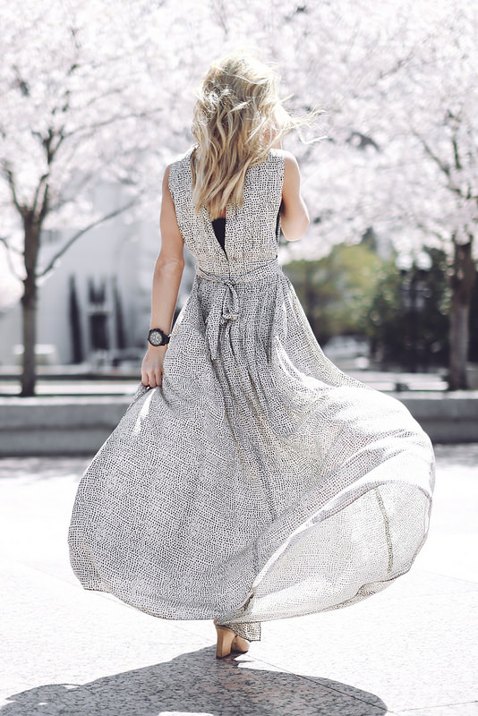 Just The Design: Mary is wearing a grey L'agence maxi dress