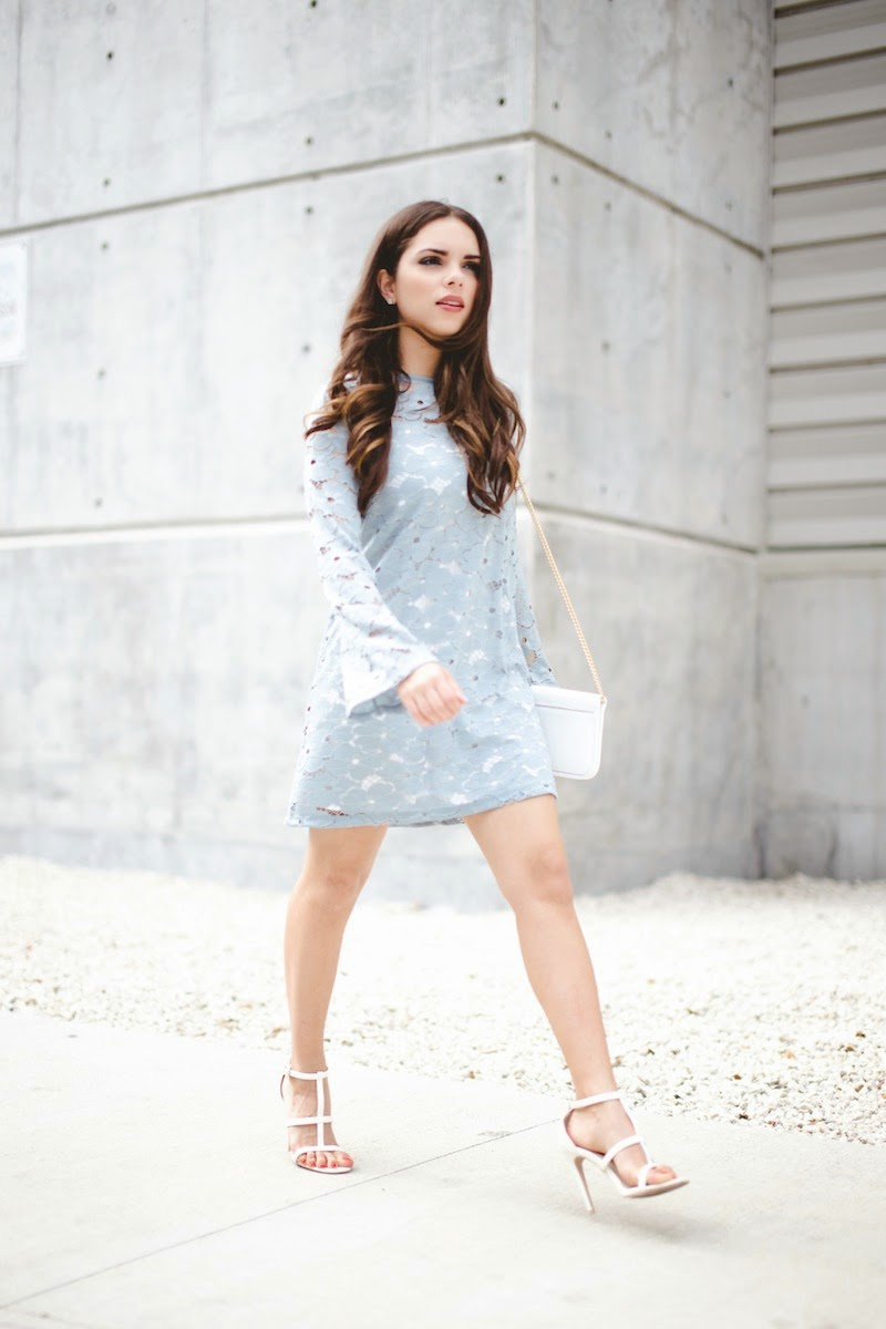 Accessorise A Lace Dress: Daniela Ramirez is wearing a baby blue Motel Rocks lace dress with a Henri Bendel handbag