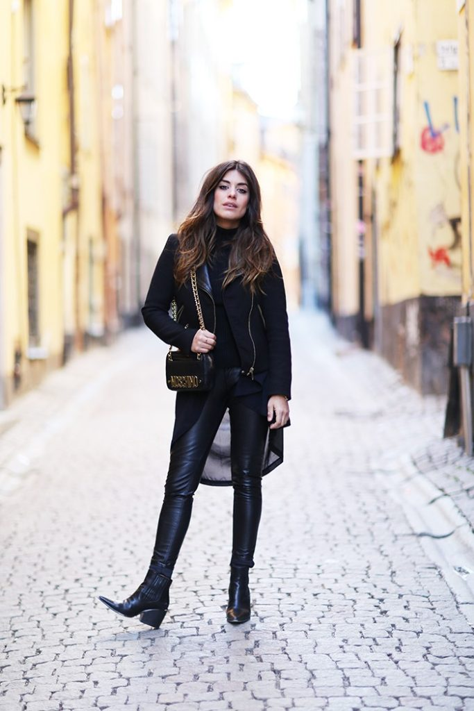 All Black Outfit Ideas: Aida Domenech is wearing a Zara jacket, an oversized Monki cardigan, leather H&M trousers and Asos ankle boots