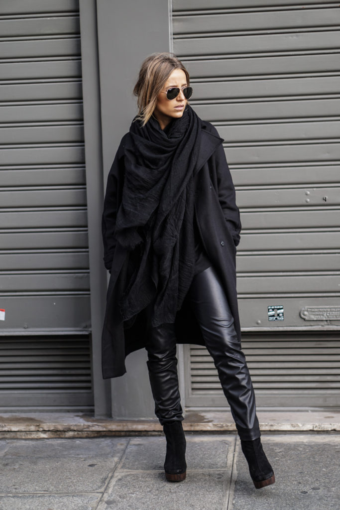 Camille Callen's all black outfit consists of a chic rain mac, leather trousers, and heeled ankle boots.   Jacket/Blouse/Trousers: Topshop, Scarf: Mango.