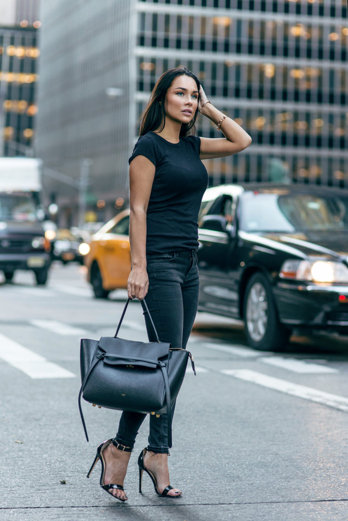 Johanna Olsson keeps it sweet and simple in a black tee and matching skinnies.   Jeans: Zara, Top: Enza Cozta, Bag: Celine, Shoes: La Strada.