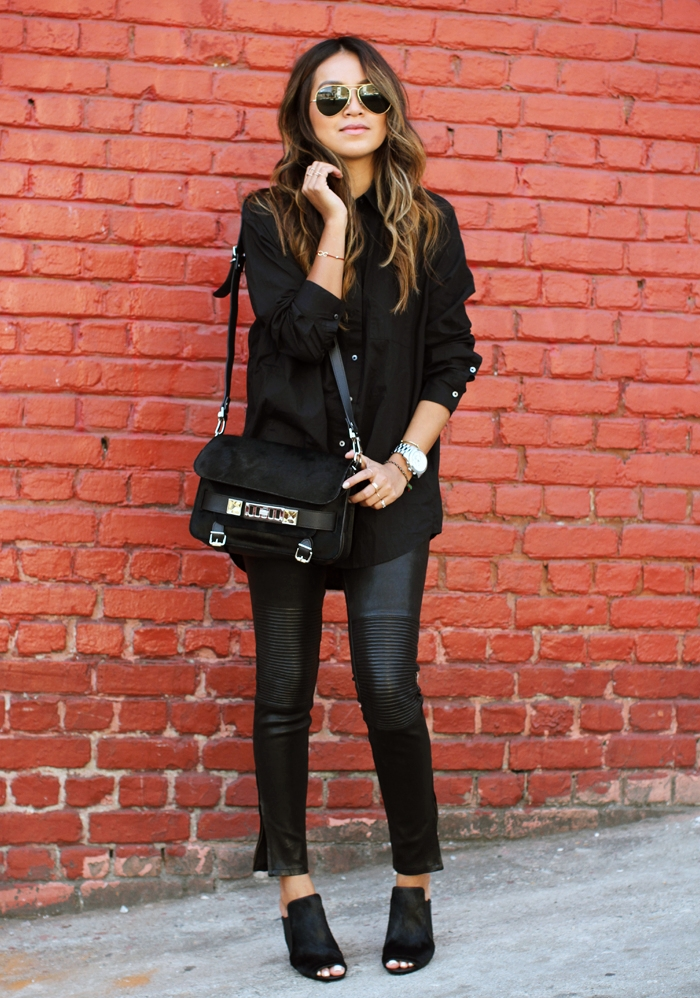 A black button up will look edgy and androgynous worn with leather trousers and matching black mules. This silk shirt is the perfect mix of sophistication and rocker girl chic. Via Julie Sarinana. Leather Trousers: J Brand, Mules: 3.1 Phillip Lim, Bag: Proenza Schouler.