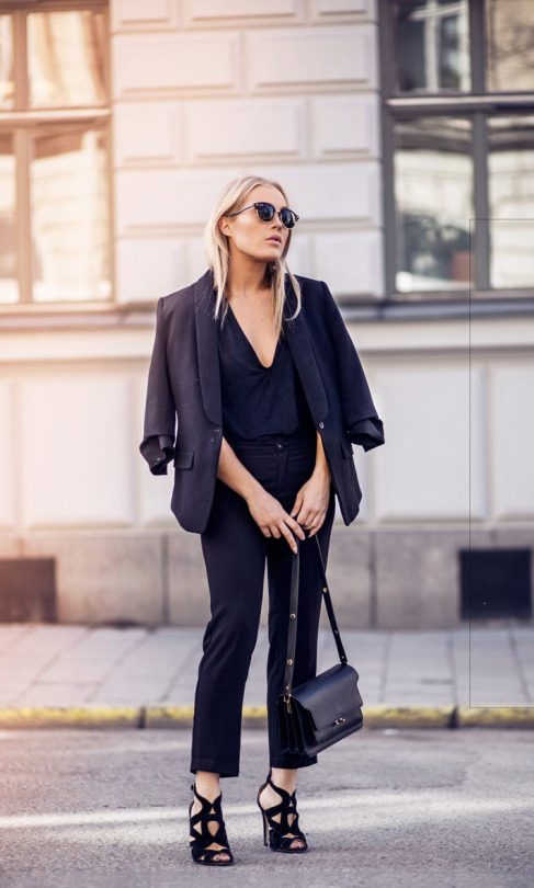 Angelica Blick is looking totally sleek in this all black outfit, consisting of a plunge neck tee, a pair of fitted cigarette trousers, and an oversized one-button blazer. Glam this look up by adding a pair of striking stilettos, if you dare! Jacket: Gina Tricot, Trousers: Sanne Alexandra, Shoes: Zara.
