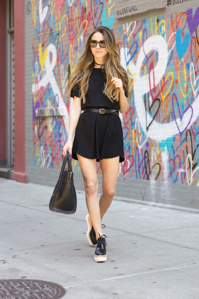 e40286378f Wearing a black playsuit like this one will always guarantee you a cute and  understated style