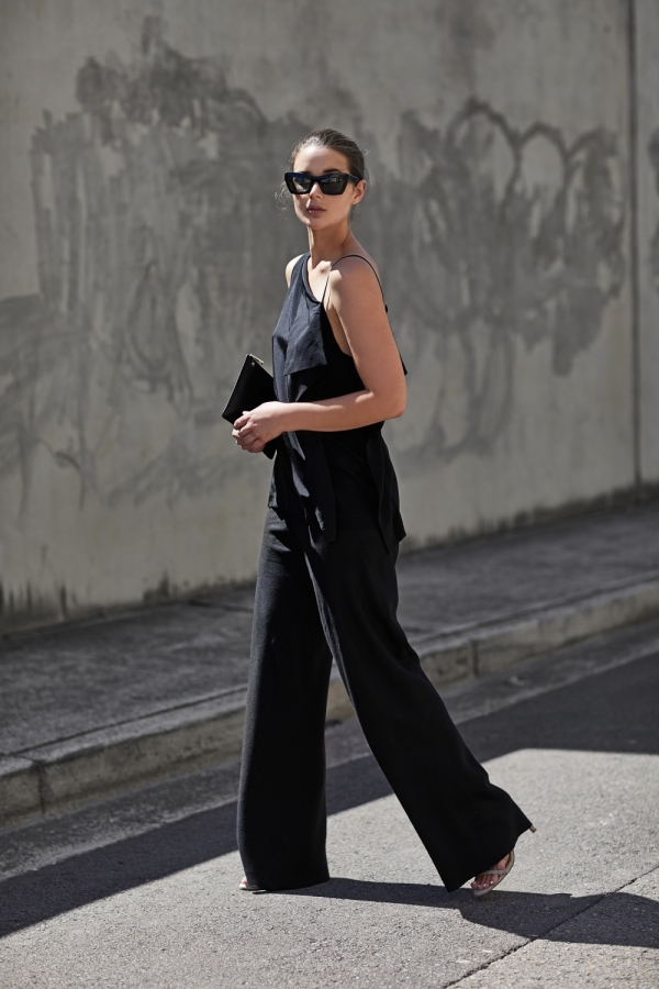 Sara Donaldson has created the perfect silhouette here in a one-shouldered vest top and a pair of flared culotte trousers. We love the striking nature of this look as an all-black style.   Top: Dion Lee, Trousers: Christopher Esber, Bag: Daily Edited.