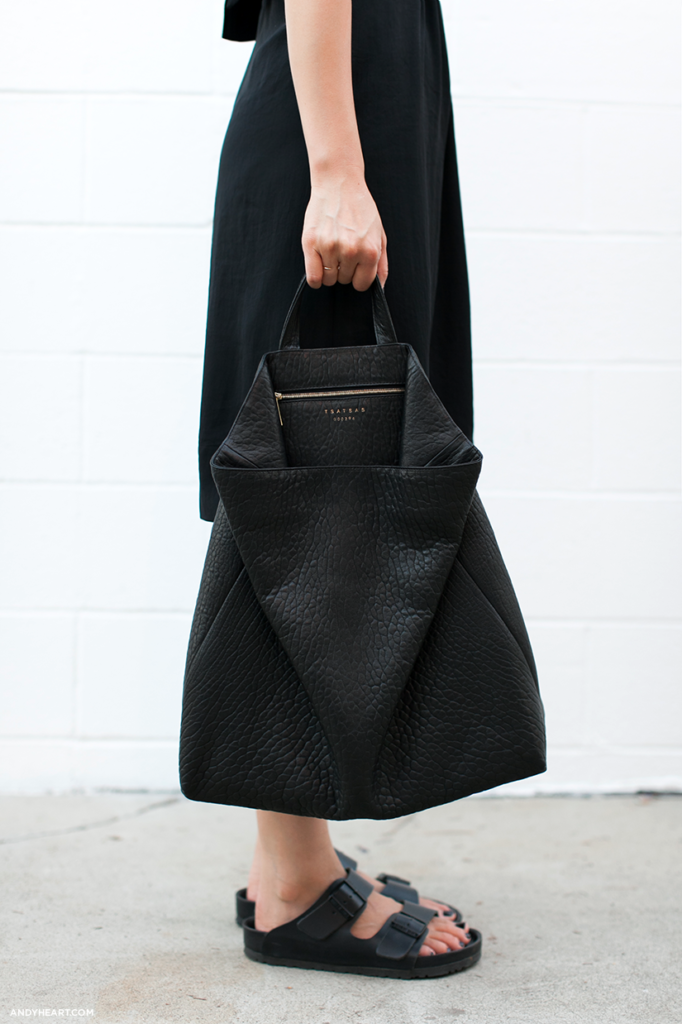 Ann Kim is wearing a black wray dress from A.L.C, black bag from Tsatsas and black sandals from Birkenstock