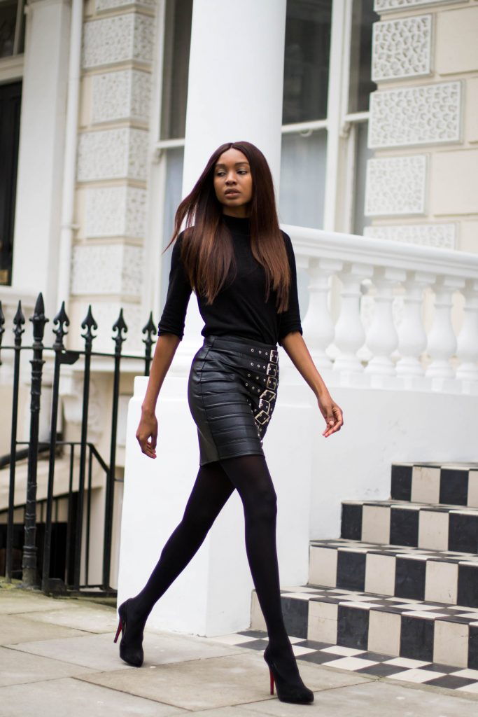 Natasha Ndlovu is striking and sleek in this classic all black style; a punk-esque black leather skirt and a black turtleneck! Wear this look with heels to get that edgy glam which Natasha is rocking! Jumper: H&M, Skirt: Missguided.