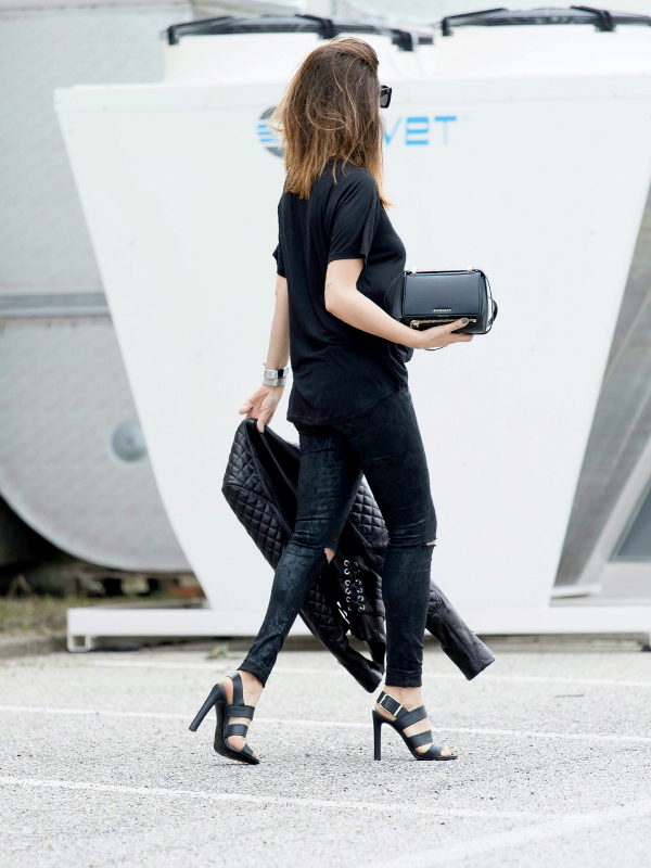 So much attitude in this black outfit. Both the black leather jacket and shoes rock. Via Nicoletta Reggio  Jacket: Balenciaga, T-Shirt: H&M, Pants: Jennifer Bag:Givenchy, Shoes: Sarenza