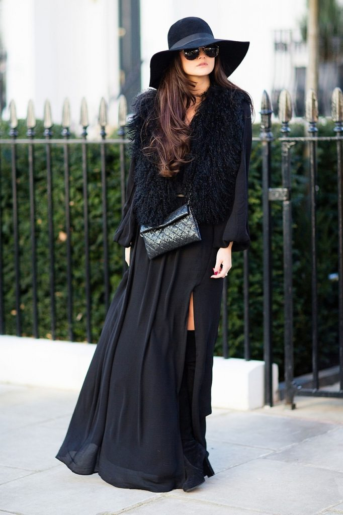 Dramatic look for a windy and rainy day. Black will work. Via Peony Lim  Hat: Joseph, Dress: Mango, Bag: Chanel, Gilet: Zara