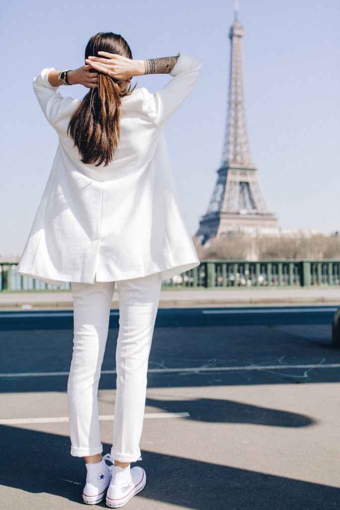 Alexandra Guerain is wearing an all white suit from Kiabi with white Converse