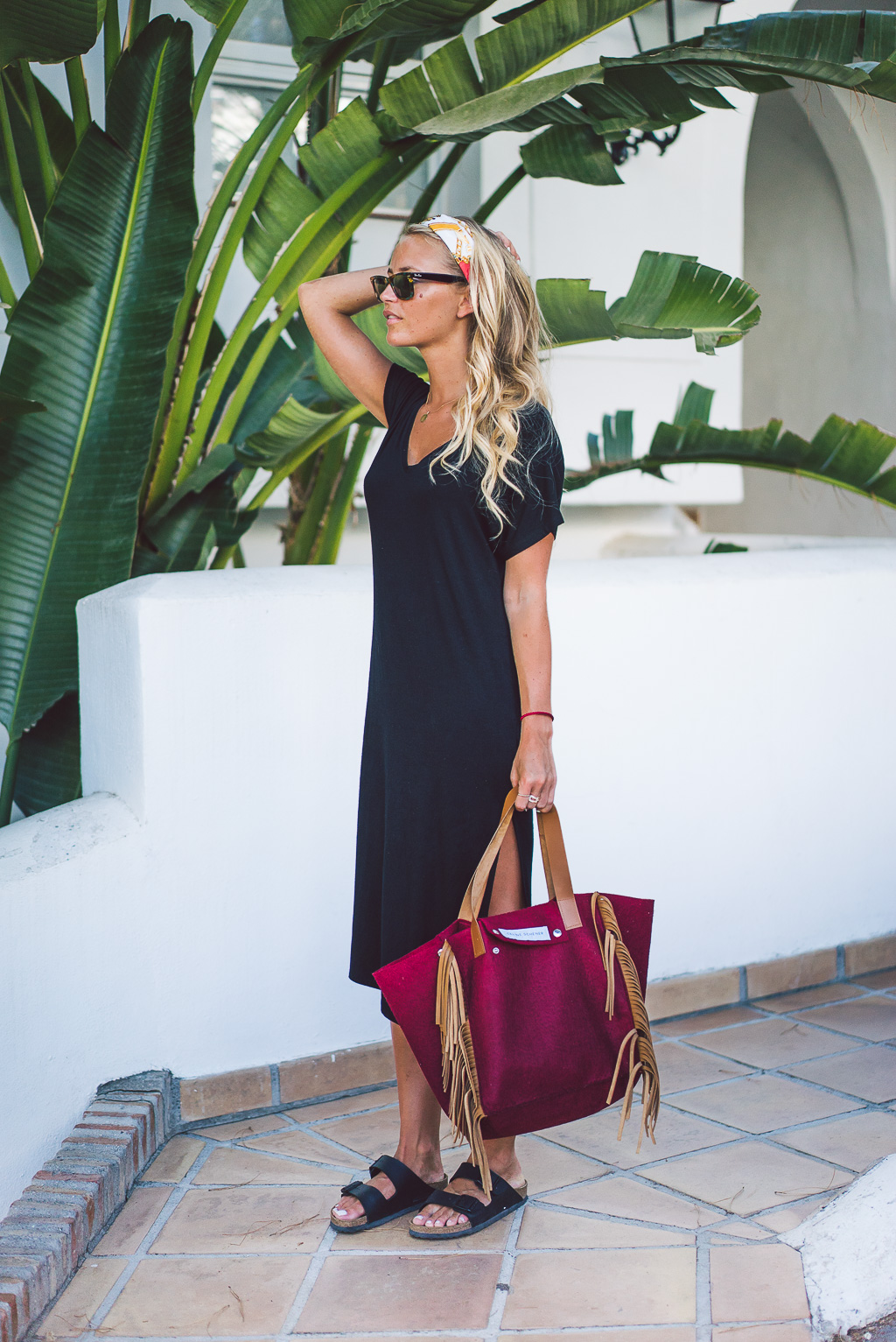 The bandana can we worn in many ways. Here worn as a head band. Via Janni Deler. Bag: Celine Schener, Shoes: Birkenstock