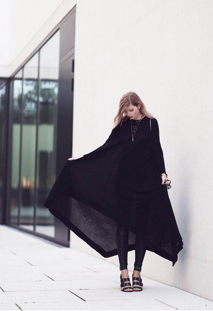 The long over long trend illustrated well with this all-black outfit. Via Jana Wind  Dress: COS, Leggings: Asos, Shoes: Zara