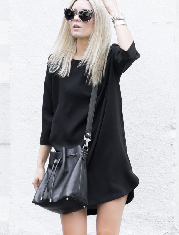 Love the black bucket bag and the simple black dress. Via Figtny  Dress: Oak & Fort, Bag: Proenza Schouler, Sunglasses: Vrai & Oro. Black Outfits