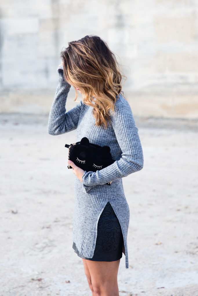 Street Style, April 2015: Sara Escudero is wearing a grey Zara long sleeved top with a black mango skirt and an Asos clutch bag
