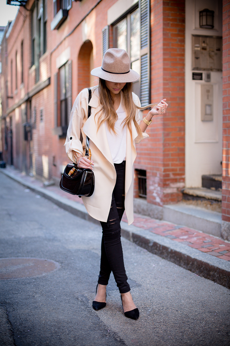 Pam Hetlinger is wearing a creme draped trench coat from Sheinside