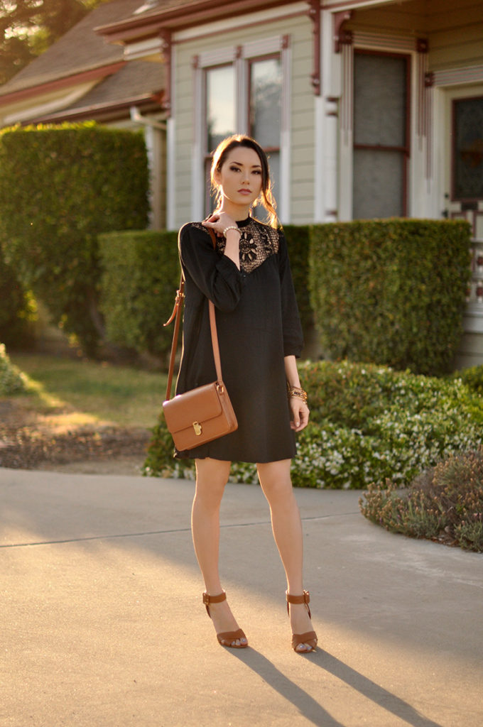 Jessica R. is wearing a black Sheinside dress with a pair of Charlotte Russe beige heels and a sidebag from Similar