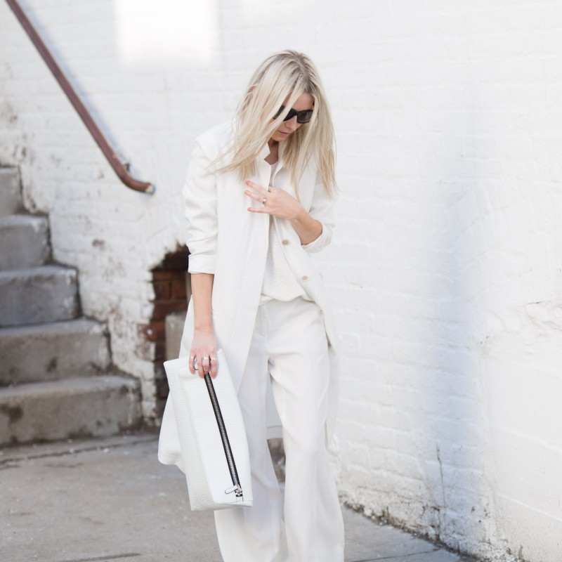 All White Outfits 2015: Figtny is wearing a Mango sweater, Asos trousers, a white mac coat and clutch bag