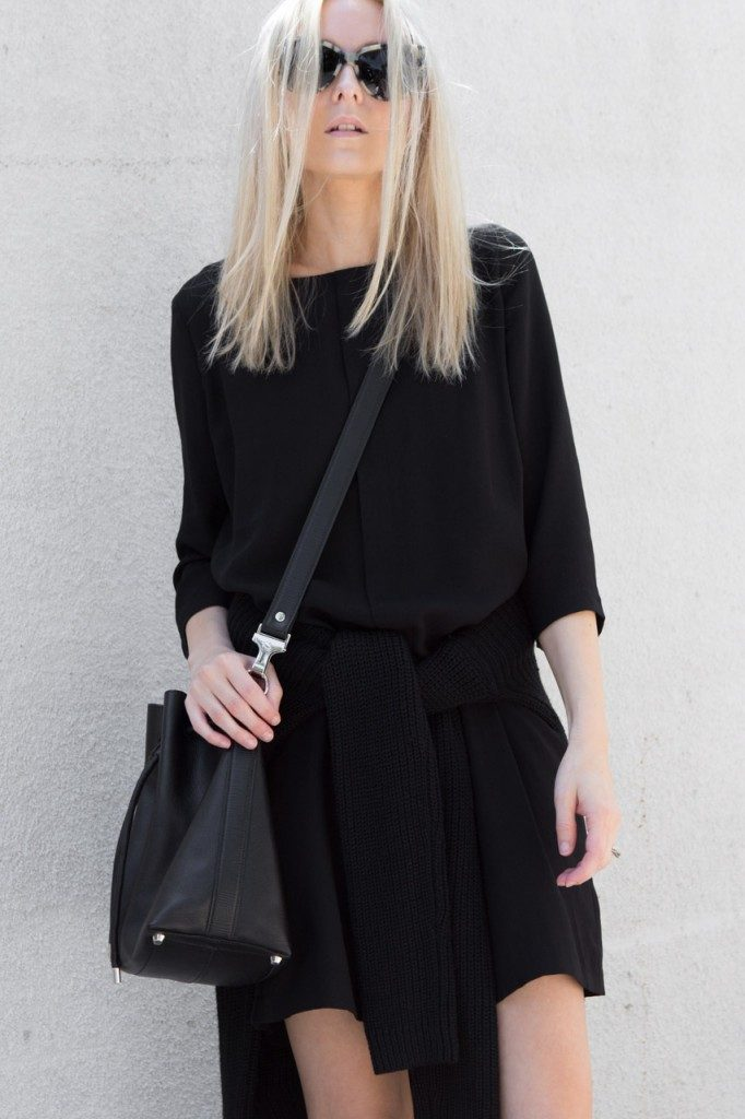 Best All Black Outfits: Figtny is wearing a 3056 black tunic dress with an Oak And Fort sweater
