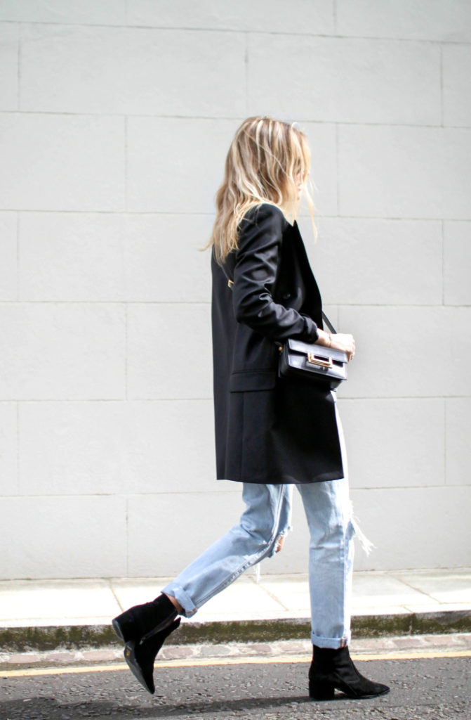 Lucy Williams is wearing an oversized Alexander McQueen blazer with a pair of light denim Levi 501′s and black Aldo booties