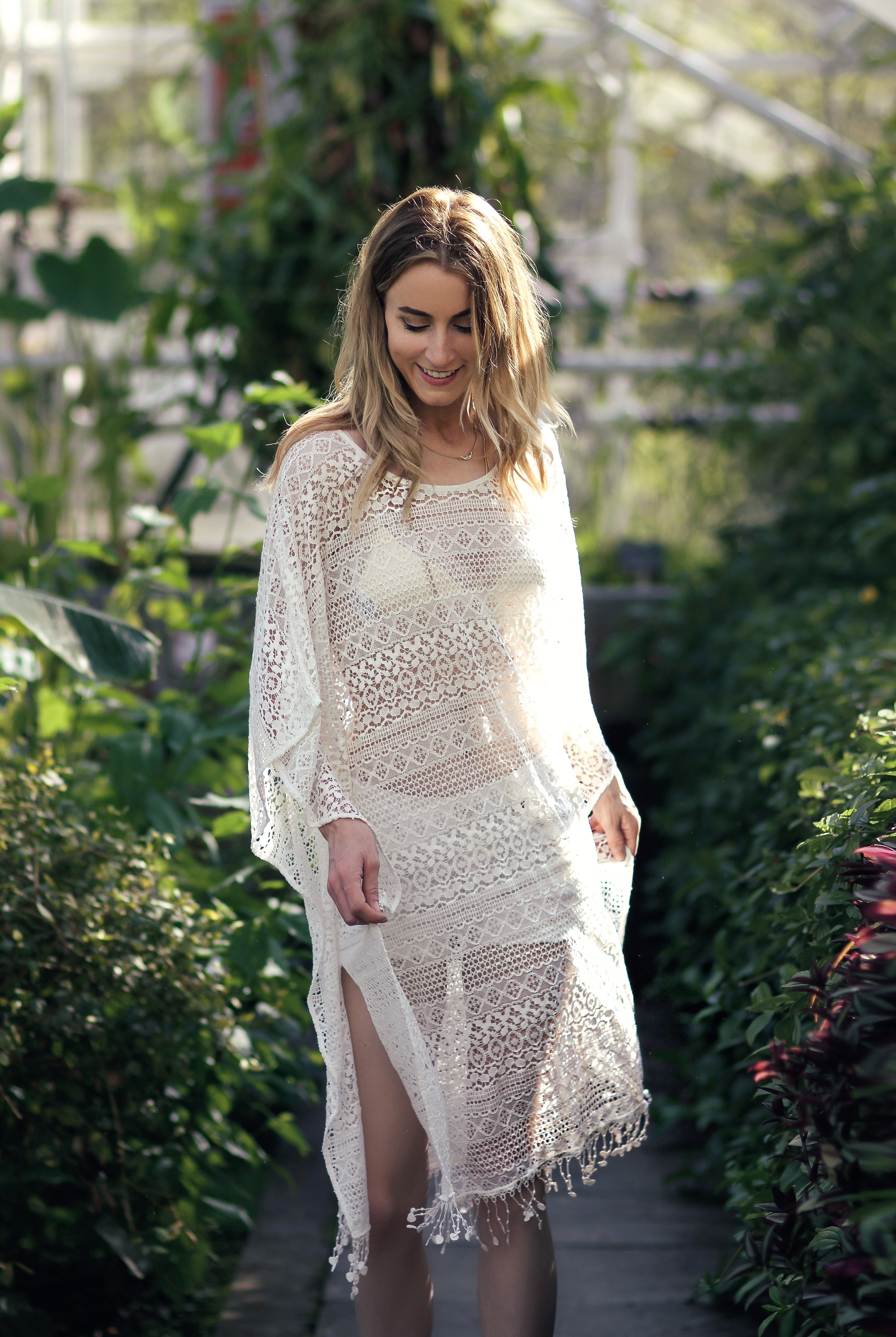 Lace Outfit Ideas: Noor De Groot is wearing a white lace tunic
