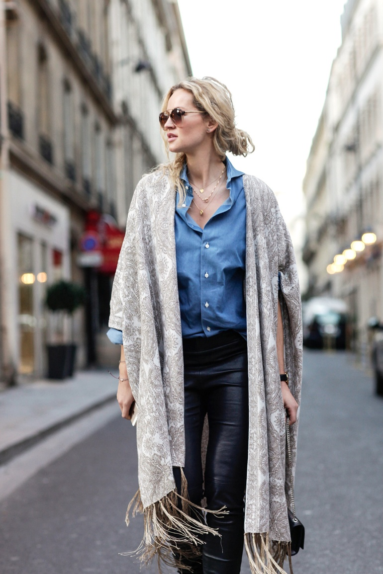 Anouk Yve is wearing a khaki and white kimono from Free People