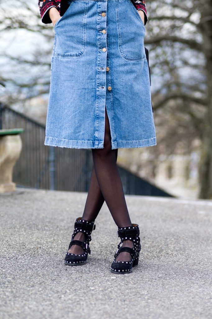 Street Style Via Just The Design: Soraya Bakhtiar is wearing denim button downed dungaree dress from Zara paired with Laurence Dacade black studded ankle boots