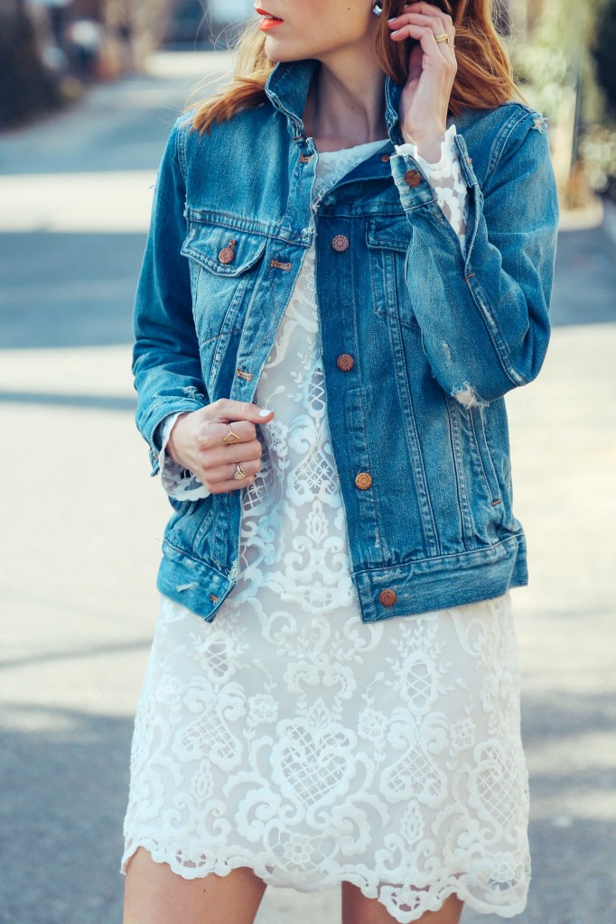 Jess Ann Kirby is wearing a white lace dress and denim jacket from French Connection and Madewell respectively
