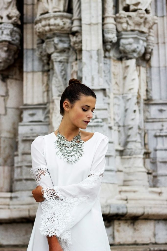 Barbara Ines is wearing a white lace trimmed dress from Sheinside