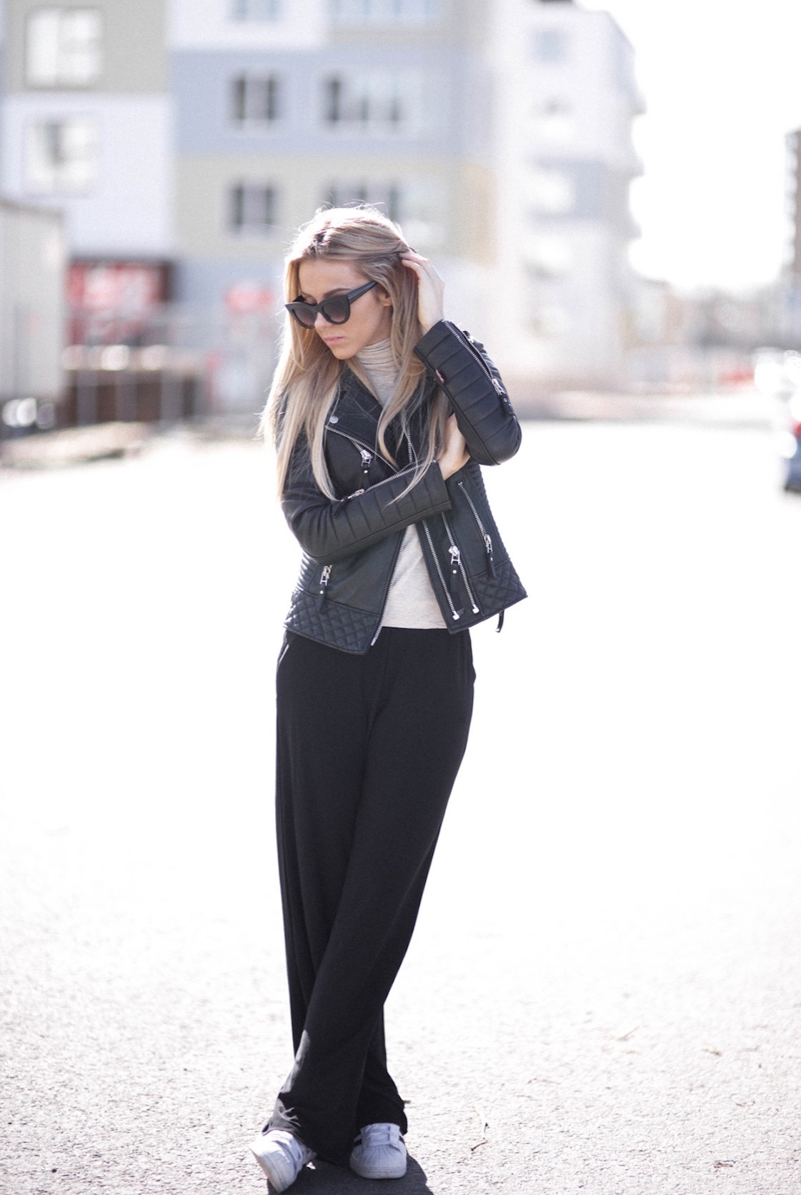 Street Style: Sendi Skopljak is wearing a leather jacket from Boda Skins and the wide leg trousers are from Lindex