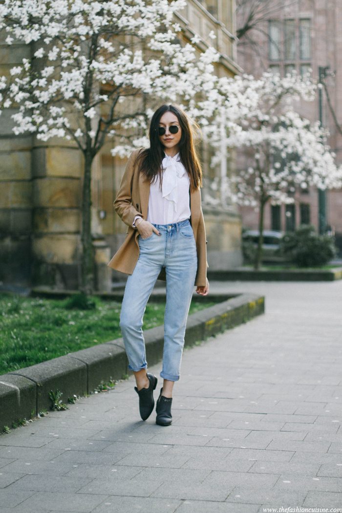 Beatrice Gutu is wearing a brown blazer from Front Row, white blouse with bow from Gnossem and the jeans and shoes from Forever 21