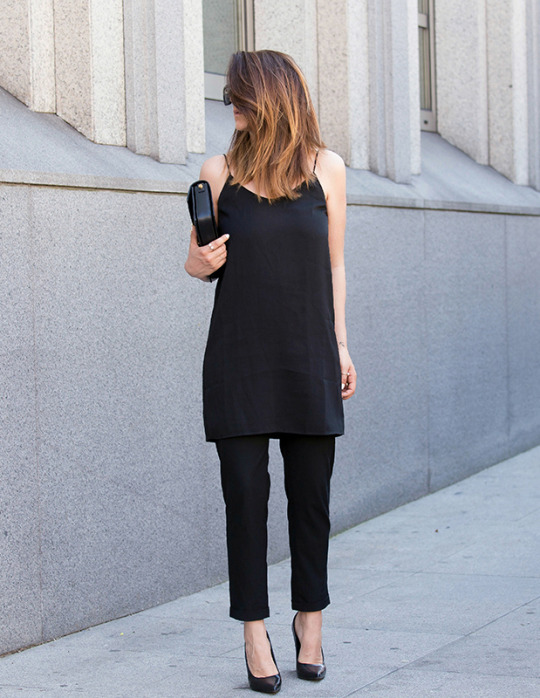 How To Style An All Black Outfit: Nicoletta Reggio is wearing a camp dress from Mango with a pair of trousers from Zara, Sarenza heels and a Saint Laurent clutch bag