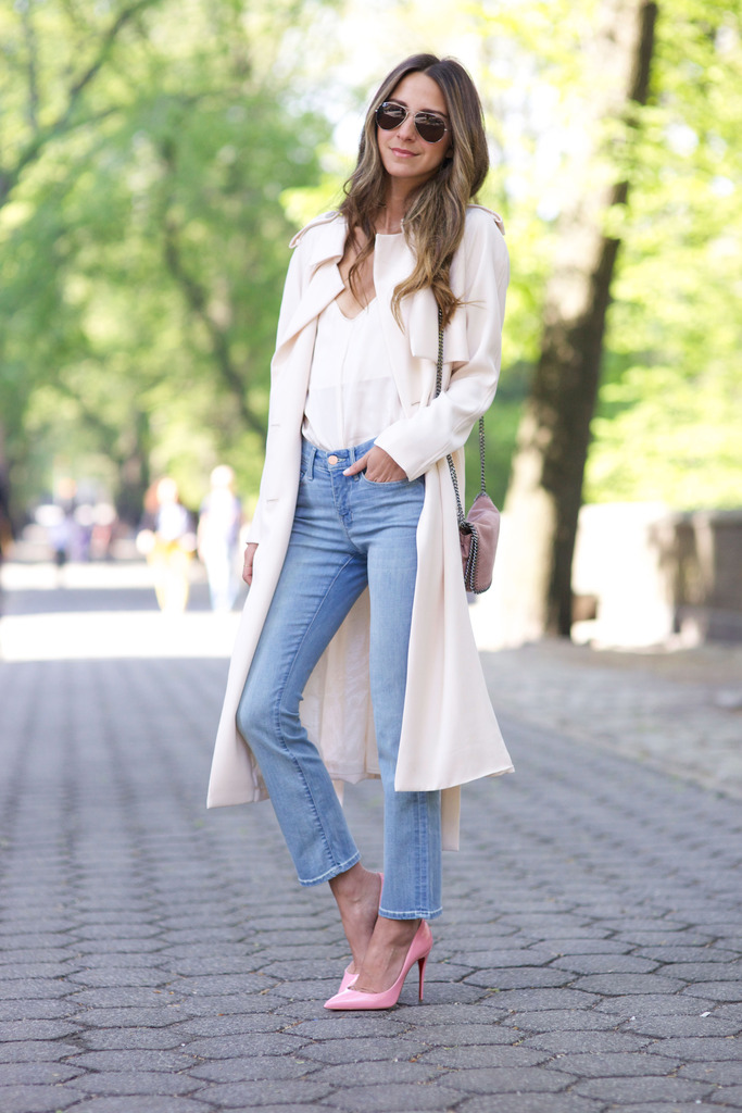 Draped Trench Coat & Jeans: Arielle Nachami is wearing a creme draped maxi trench coat