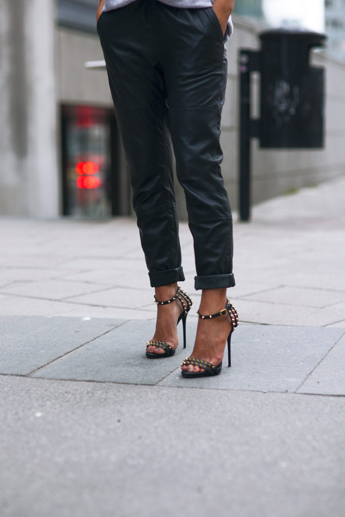 Street Style, April 2015: Johanna Olsson is wearing a pair of black leather Designers Remix trousers with studded Giuseppe Zanotti heels