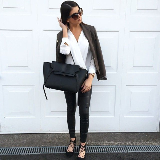 Instagram Fashion, April 2015: FASHIONBYMNP is wearing a crisp white shirt from Topshop, black leather trousers with lace up flats, a Céline tote bag and sunglasses paired with a Mango gold detailed blazer