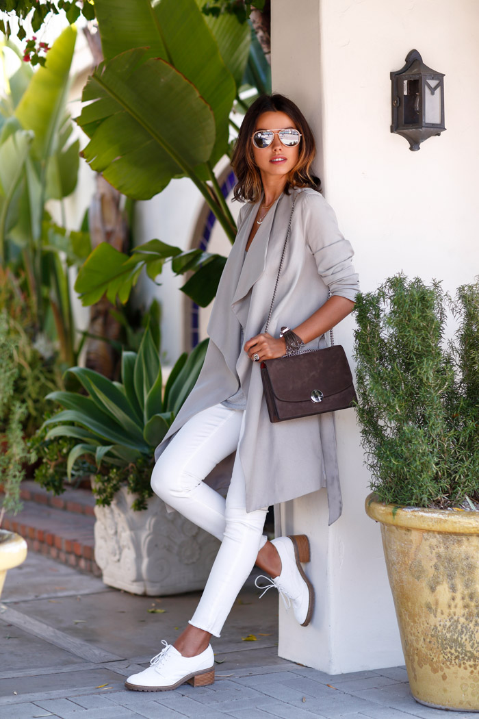 Annabelle Fleur in a pale grey draped trench coat from All Saints