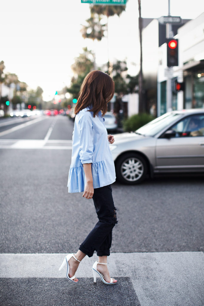 Jenny is wearing a baby blue H&M ruffled shirt with distressed One Teaspoon boyfriend jeans and white Asos heels