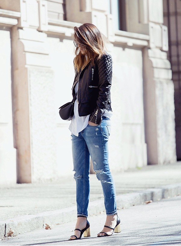 Just The Design: Nicoletta Reggio is wearing a black Balenciaga leather jacket with distressed Zara jeans and heels from Senso