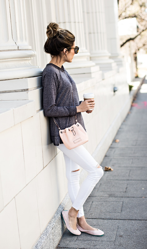 Christine Andrew is wearing a pair of Topshop white skinny jeans with blush pink Nordstrom pumps and a grey Stem long sleeved t-shirt