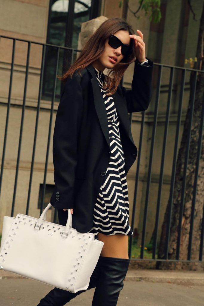 Best Of Instagram Fashion: Patricia Manfield is wearing an Asos pinstripe dress with a black tailored blazer, Celine sunglasses, leather Cinti boots and a pearl white J&C handbag