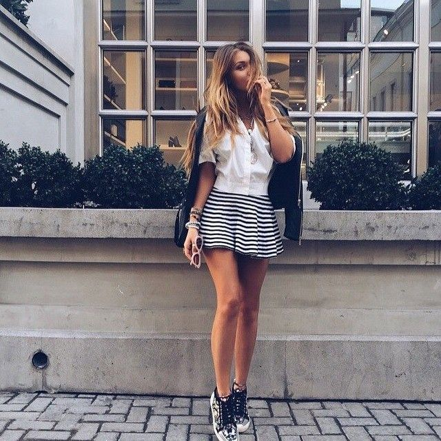 Instagram Fashion 2015: NATALI LITVINOVA is wearing a pinstripe mini skirt paired with a black leather jacket and sneakers