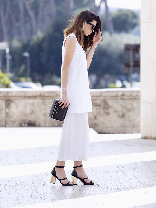 An All White Outfit: Nicoletta Reggio is wearing a sleeveless dress from Zara over a pair of Proenza Shouler pants