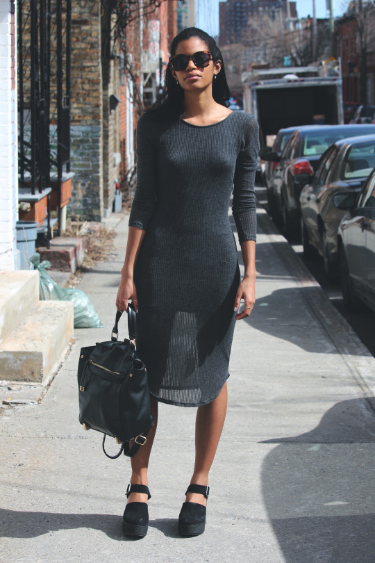 Street Style, April 2015: C is wearing a grey knee length Urban Outfitters dress with a leather Topshop backpack and Zara heels