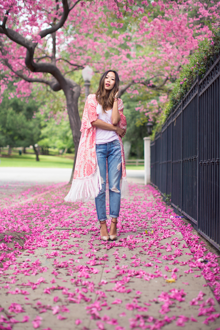 Kimono Outfits For Summer 2015: Aimee Song is wearing a pink fringed Athena Procopiou silk kimono