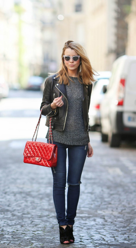 Caroline Louis is wearing an Iro glitter grey top styled with a black leather Acne biker jacket, Frame denim skinny jeans and black Chanel heels