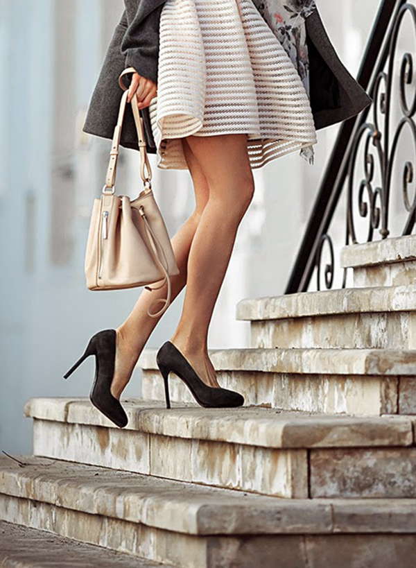 Tini Tani is wearing a creme dress with an Asos handbag, suede Corso Como heels and an AC coat