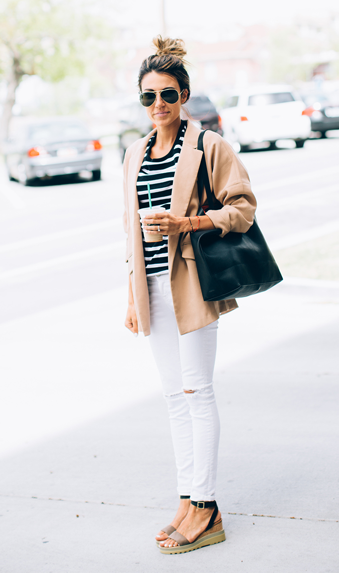 Street Style Fashion: Christine Andrew is wearing an Old Navy striped tee, white denim jeans from Joe's, a camel Forever 21 blazer, Chloe wedges and a black tote bag