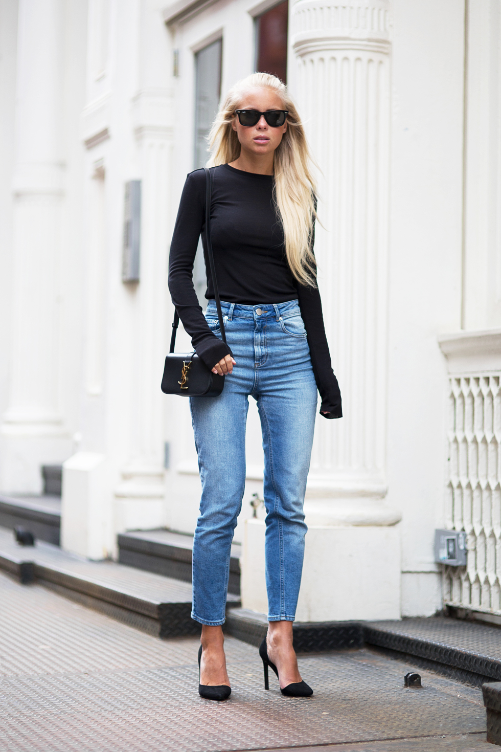 Just The Design: Victoria Tornegren is wearing a black long sleeved H&M top with a pair of light wash Asos jeans, NLY heels and a YSL sidebag