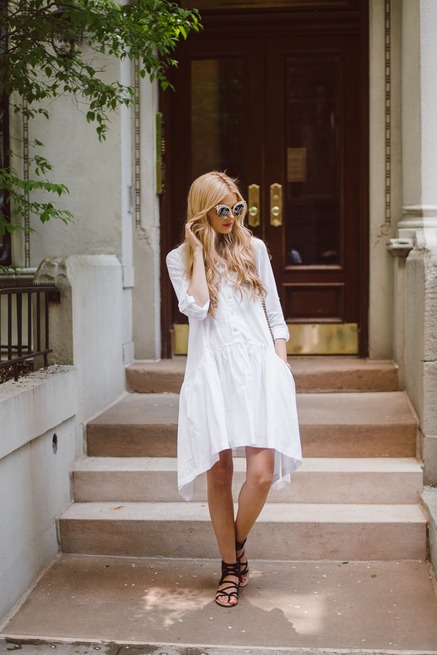 Accessorise A White Dress: Amber Fillerup Clark is wearing a DKNY dress